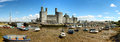 Low tide at caernarfon panorama of caenarfon identifying marks removed and people not recognizable when viewed Stock Image