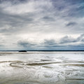 Low tide in mont saint michel bay normandy france landmark europe Royalty Free Stock Photo