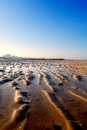Low tide in the morning with blue sky Stock Images