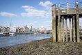 Low tide river thames and london city skyline including st paul s cathedral Royalty Free Stock Photography