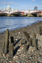 Low tide river thames and london city skyline including st paul s cathedral Royalty Free Stock Photos
