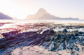 Low tide with Rocks in front and on sunrise and amazing shape of Cadlao Island in background, El-Nido, Palawan Royalty Free Stock Photo
