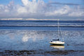 Low tide with a white boat in tagus river near lisbon Stock Photos