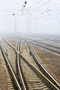 Low visibility railway station in the fog Stock Photography
