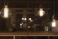 Low watt tungsten bulbs hanging from cord Royalty Free Stock Image