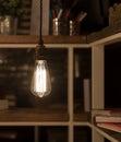 Low watt tungsten bulbs hanging from cord Stock Photos