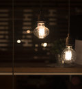 Low watt tungsten bulbs hanging from cord Royalty Free Stock Photography