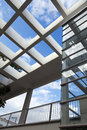 Low wide angle view large pergola glass elevator shaft Stock Photos