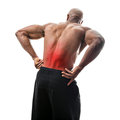 Lower back pain fit man or athlete reaching for his in with the painful area highlighted in red Stock Images