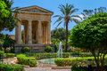 Lower barrakka gardens and the monument to alexander ball in valletta Stock Photo