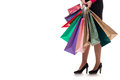 Lower close-up, girl stands holding shopping paper bags and pack Royalty Free Stock Photo