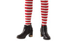Lower half of girl wearing stripey socks and boots on white background Royalty Free Stock Photography