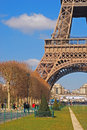 Lower half view of eiffel tower paris with green grass and blue sky in early spring Stock Photo