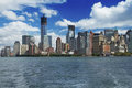 Lower Manhattan and blue sky with clouds Stock Image