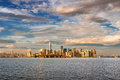 Lower Manhattan Financial District Skyscrapers and Ellis Island in late afternoon from New York Harbor Royalty Free Stock Photo