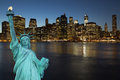 Lower manhattan in the night concept of statue of liberty new york city usa Royalty Free Stock Image