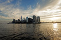 Lower manhattan panorama of the east river in rays rising sun Stock Photography