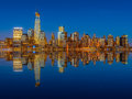Lower manhattan skyline at night reflected in water Stock Photography