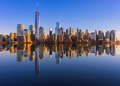 Lower manhattan skyline panorama over east river with reflection at sunset Royalty Free Stock Image