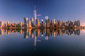 Lower manhattan skyline panorama over east river with reflection at sunset Stock Image