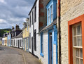 Lowland scottish town street in the of moffat dumfries and galloway showing variety of traditional building styles with colourful Stock Photo