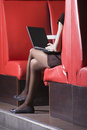 Lowsection Of Businesswoman Using Laptop In Cafe Royalty Free Stock Photo
