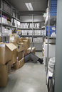Lowsection Of Man With Laptop On Floor In Storage Room Royalty Free Stock Photo
