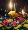 Loy krathong festival in thailand candal light and flower floating river under full moon night Stock Image