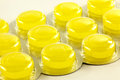 Lozenges in blister pack a closeup of yellow throat a Royalty Free Stock Image
