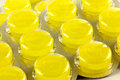 Lozenges in plastic pack a closeup of yellow throat a blister Stock Photos