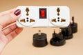 Lplug socket in hand and universal adaptor set Royalty Free Stock Photo