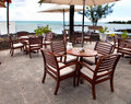 Ltables in cafe in tropics a sunny day Royalty Free Stock Photo