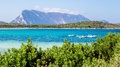 Lu impustu beach in Sardinia, with Tavolara island in the backgr Royalty Free Stock Photo