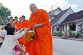 Luang prabang lao may every day very early in the morning monks walk streets to beg give food offerings to a buddhist monk Royalty Free Stock Image
