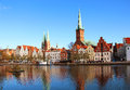 Lubeck old town germany with marienkirche st mary s church and petrikirche st peter s church reflected in trave river Royalty Free Stock Photos