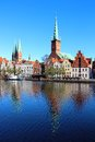 Lubeck old town germany with marienkirche st mary s church and petrikirche st peter s church reflected in trave river Stock Images