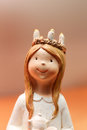 Lucia closup of small figurine with candles in her hair Stock Photos