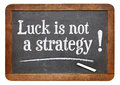 Luck is not a strategy advice on vintage slate blackboard Royalty Free Stock Photography