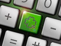 Luckiness button four leafed clover on the keyboard Royalty Free Stock Images