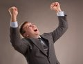 Lucky businessman office worker in a suit celebrates victory Stock Image