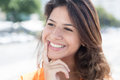Lucky caucasian woman in a orange shirt Royalty Free Stock Photo