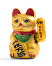 Lucky charm cat gilded chinese asian or feng shui with a paw raised in greeting denoting wealth and prosperity over a white Royalty Free Stock Photo