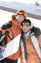 Lucky couple  snowboarders  in a mountain valley Royalty Free Stock Photos