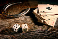 Lucky craps dice and poker cards by old horseshoe american west legend antique game rolling out chance a number seven vintage with Stock Photography