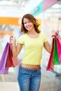 Lucky day vertical image of a girl being satisfied with her shopping Royalty Free Stock Photography