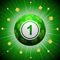 Lucky four leaf clover bingo ball with green design on a green background with gold shamrocks and stars Stock Photography