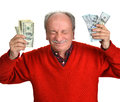 Lucky old man holding dollar bills on a white background Royalty Free Stock Photo