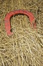 Lucky red horseshoe a is nestled in s hay bale Royalty Free Stock Photography