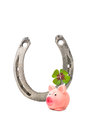 Lucky symbols old metal horseshoe four leaf clover and pig Royalty Free Stock Image