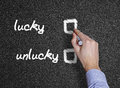 Lucky and unlucky handwritten with white chalk black background Stock Image